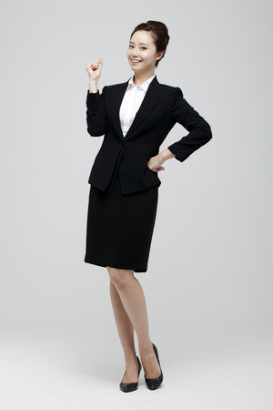 Young Businesswoman In Suit Standing