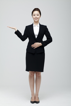 usher: Young Businesswoman In Suit Standing