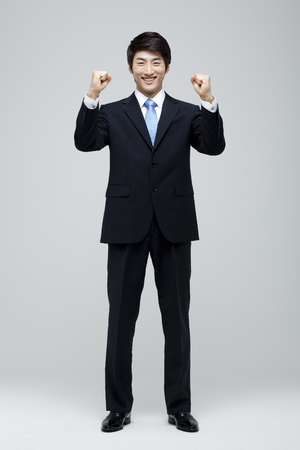 Young Businessman In Full Suit