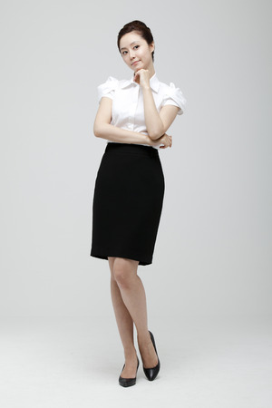 Young Businesswoman With Jacket Off Standing Stock Photo