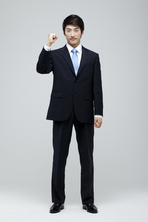 fist pump: Young Businessman In Full Suit