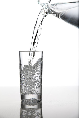 poured: Water Being Poured Into A Cup