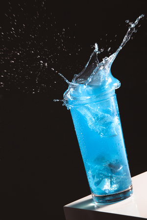 Blue Soda Making A Splash In A Glass Cup Stock Photo