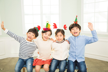 Young Children Sitting Together In A Room Stock Photo