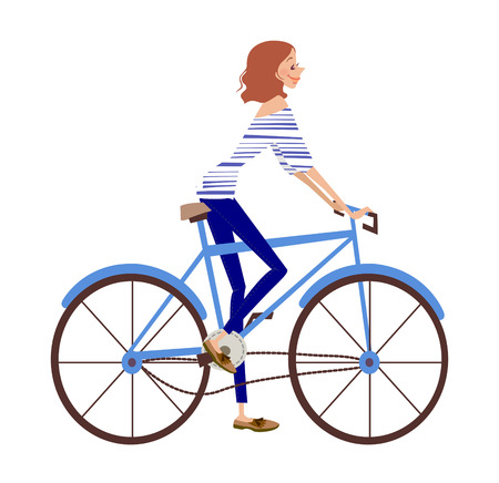 side view of woman riding bicycle