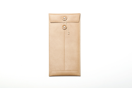 beige: Beige leather envelope-isolated on white