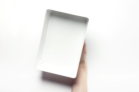 box size: Close up shot of two hands holding and opening white plastic containers-isolated on white