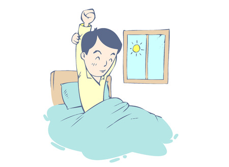 Young man stretching as he is getting up from bed