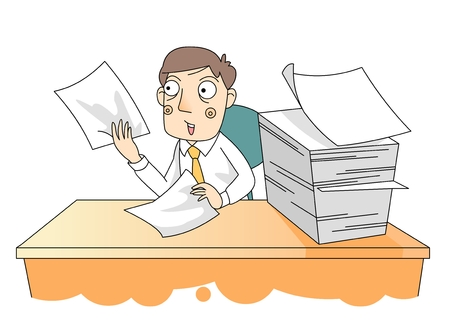 A man sitting at his desk going through paperwork