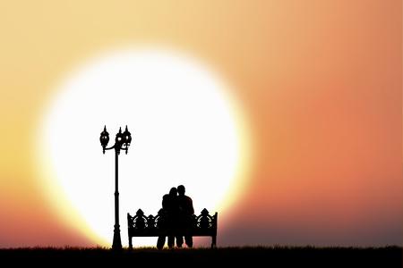 humilde: Shadow of couple sitting on bench Foto de archivo