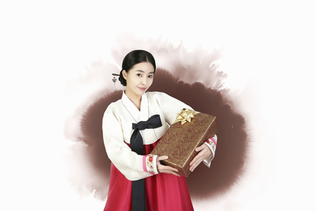 Korean girl in Hanbok holding a gift box
