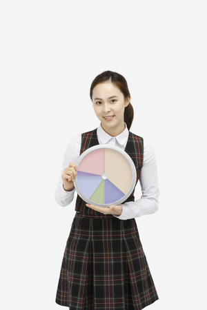 Asian girl in school uniform holding a clock