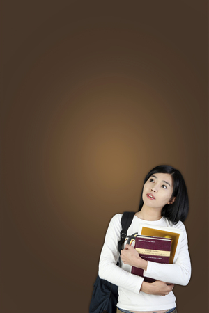 Asian female student posing with a few books Stock Photo