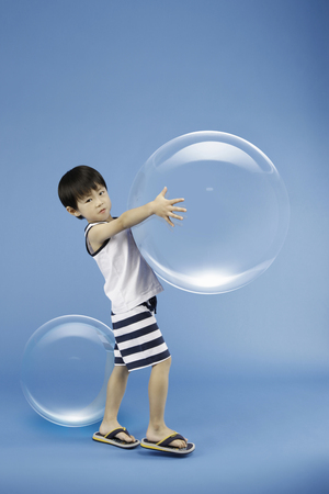 Asian boy with 3d bubbles