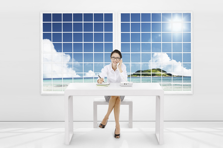 cs: Asian business woman sitting on the desk Stock Photo