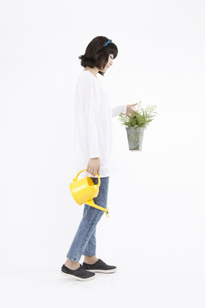 Asian students grow a plant- Isolated on studio shot