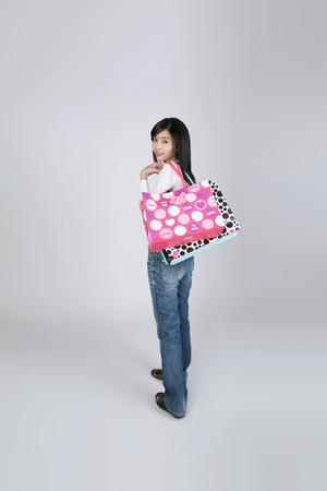 Asian students go shopping- Isolated on studio shot
