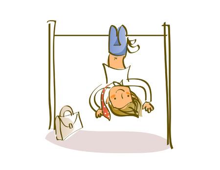 Schoolboy hanging upside down on a gymnastics bar