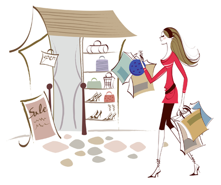 business woman: Side profile of a woman carrying shopping bags