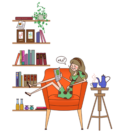 Woman sitting in an armchair and reading a book