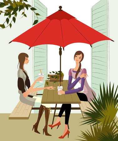 Two women sitting at a sidewalk cafe