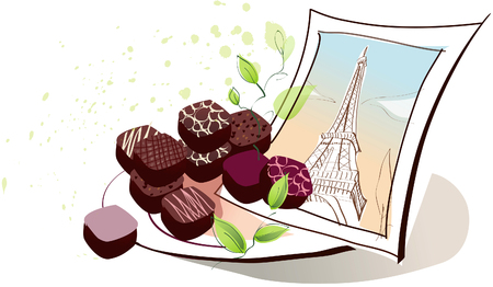 indulgence: Chocolates with a photograph of Eiffel Tower on a plate