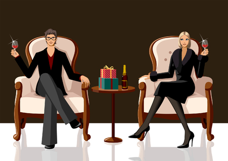 Couple sitting on armchairs and holding glasses of red wine