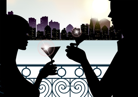 Silhouette of a couple toasting with martini glasses