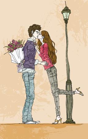 innamorati che si baciano: Man and woman kissing by lamp