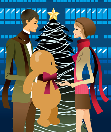 Man giving woman gift, Christmas tree in background