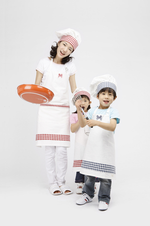 Asian students and kids with cooking concept- Isolated on studio shot Stock fotó