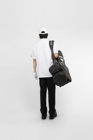 caddie: golfer- Isolated on studio shot