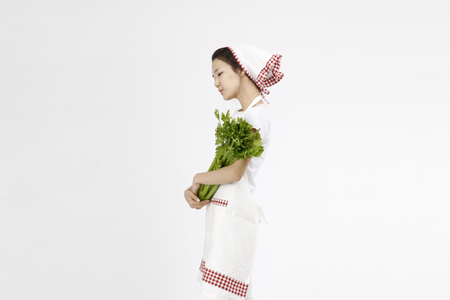 korean salad: Asian students with cooking concept- Isolated on studio shot