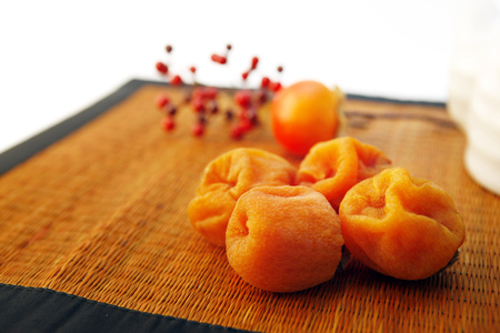 Dried persimmons with tea, autumn atmosphere