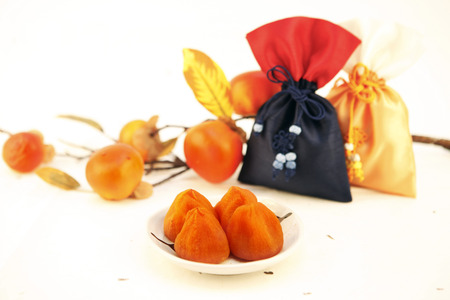 Dried persimmons with oriental silk pouches