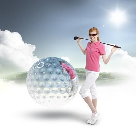 Caucasian female golfer with a 3d golf ball Stock Photo