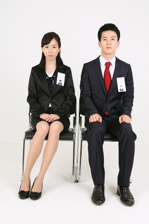 Asian business people in the studio - isolated on white