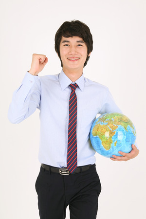 businessman carrying a globe: Asian flight attendants - isolated on white Stock Photo