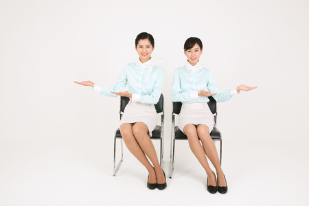 Asian flight attendants - isolated on white Stock Photo