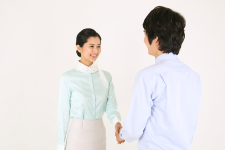 Asian flight attendants - isolated on white Stock Photo