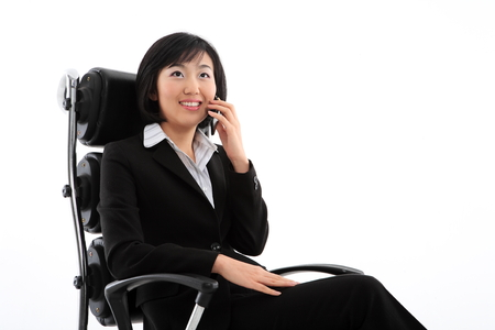 experiencing: Young Asian business people - isolated on white Stock Photo