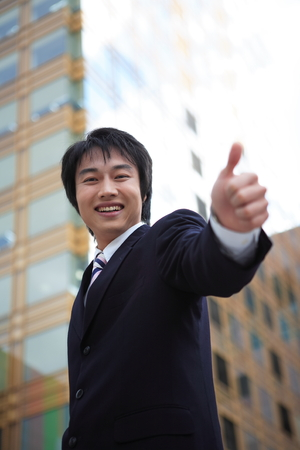 experiencing: Young Asian business people outside the office
