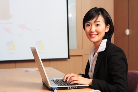 Young Asian business people at work Standard-Bild