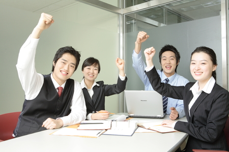 Young Asian business people working in an office Stock Photo