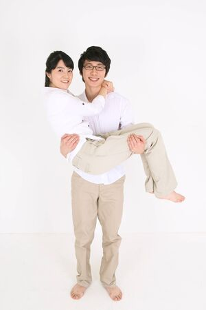 levantar peso: Young Asian couple in white shirt stretching, working out - isolated on white