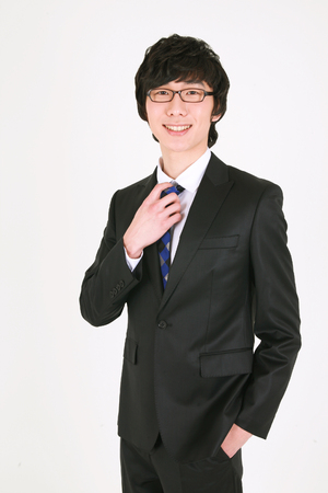 nobleness: Young Asian businessman posing in the studio - isolated on white