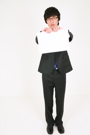 Young Asian businessman with white paper - isolated on white
