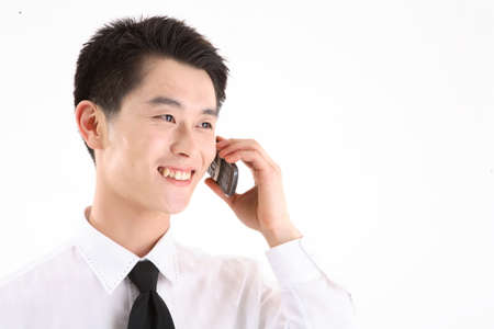 Asian businessman talking on the phone - isolated on white Stock Photo