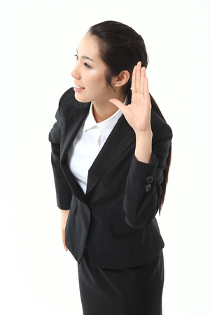 carefully: Asian businesswoman posing in the studio - isolated on white