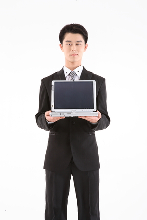 disclosure: Asian businessman with a laptop - isolated on white